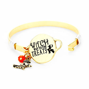 "Witch Way to the Treats Engraved Metal Disc Witch Charm Hook Bracelet, Halloween is the time of year where there is magic in the night when pumpkins glow with candlelight, we have the perfect accessories to a sparkling scary look. Dress up and have a spook-takular good time! Black, Gold, Orange; Size: 1""H ID : 2.3""D"