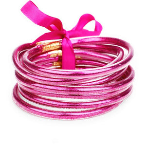 "7PC Glitter Jelly Tube Bangle Bracelet, add a pop of color to your waredrobe with the 80's inspired fashion bracelets tied together with a matching ribbon. Colors: Blue, Copper, Green, Fuchsia, Gold, Black, Lavender, Purple, Red, RoseGold Dimension: 1.5"" H, 2.75"" D"