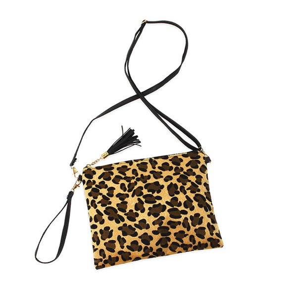 Leopard Faux Hair Crossbody Bag Leopard Faux Hair Clutch Bag Wristlet detachable strap. Ever so classic Leopard gives you the ultimate fashionista look while carrying this trendy leopard print bag! It will be your new favorite carry all crossbody. Perfect Gift Birthday, Holiday, Christmas, Anniversary, Valentine's Day