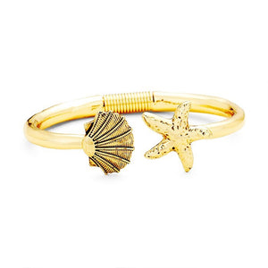 Beachy, Fun, Cayman Shell Starfish Metal Hinged Cuff Bracelet. Bring a little of the ocean to your daily look. Feel carefree as on vacation. Sea Life, bracelet goes perfect with a t-shirt, summer dress or work clothes. Great Birthday gift, Anniversary, Getaway, Beach, Vacay, Mom, Sister, Girlfriend, Summer, Sea Life