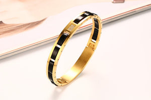 Bracelet - Modern design stainless steel with IP gold plating  with AAA cubic zirconia & black ceramic
