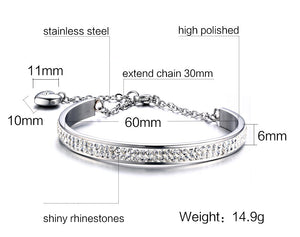 Bracelet - Elegant bracelet with shiny rhinestones extend chain with pendant in heart shape.