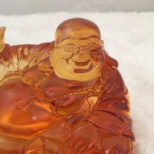 "Load image into Gallery viewer, Amore Jewell Liuli Crystal Glass - Laughing Buddha Statues With Ingots ""Maitreya Buddha""  in Amber color with base ~ 坐擁百財彌勒"