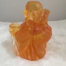"Load image into Gallery viewer, Amore Jewell Liuli Crystal Glass -  Laughing Buddha Statue bring gold bag ""Maitreya Buddha""  in Amber color ~ 黃金袋彌勒佛"