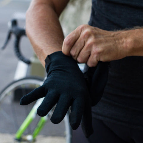 Man fitting a pair of gloves