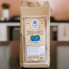 Single origin coffee in compostable bag on kitchen bench