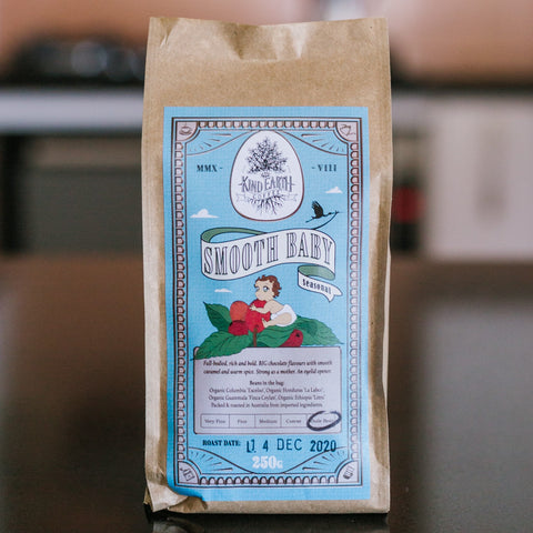 Smooth baby blend coffee in compostable packaging on kitchen bench