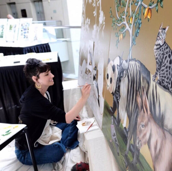 Naomi McCavitt of Thicket Design paints mural