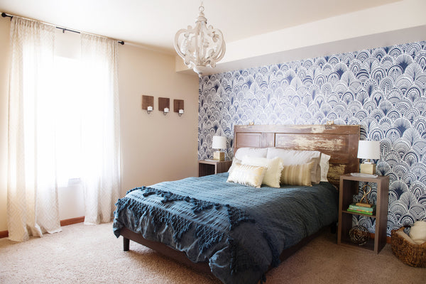 Blue bedroom with wallpaper feature wall