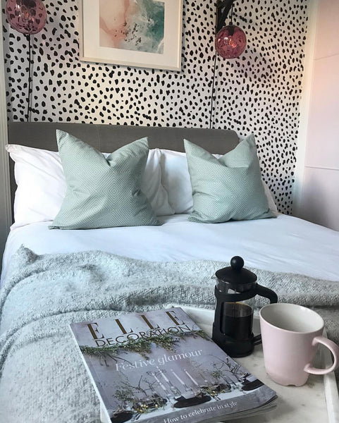 Black and white bedroom wallpaper feature wall
