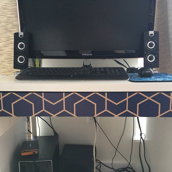Peel and stick wallpaper on a TV stand