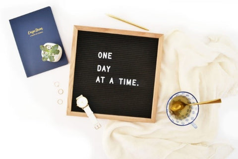 """How to make a to-do list that actually works - Sweeter Life Blog - Board with letters spelling out """"One day at a time"""""""