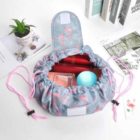 travel makeup bag in gray with flamingo design - living a sweeter life