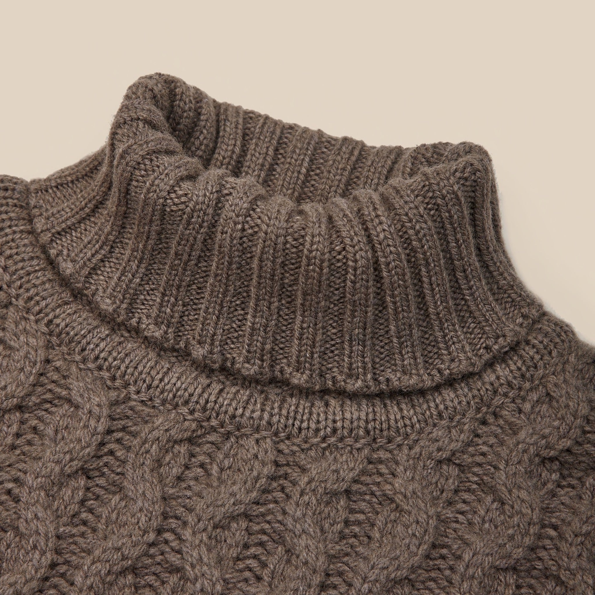 Lambswool cable knit rollneck in brown