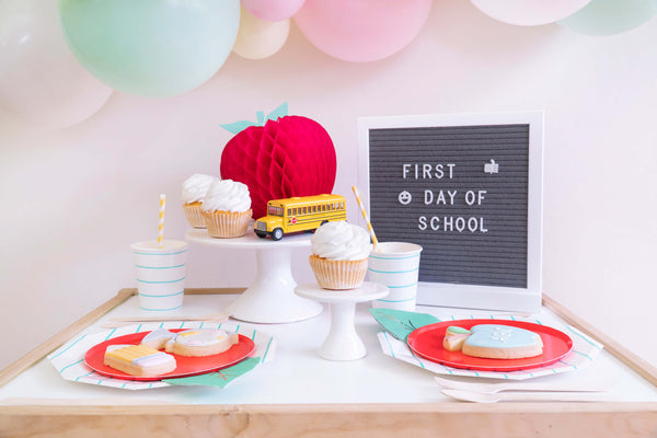 Momo party_Back to school party table set up idea with letter board, balloon garland, Apple honeycomb decoration, School bus toy, Cupcakes, Stripe paper plates, cups, Oh happy day cherry plate and cookies