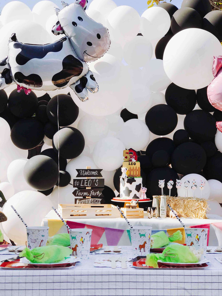 Kids Farm Birthday Party Decoration Set Up Ideas featuring cow inspired backdrop balloon wall