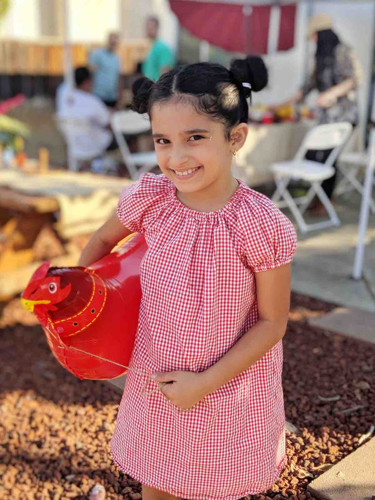 Kids Farm Birthday Party Activity Ideas Girl holding a rooster balloon
