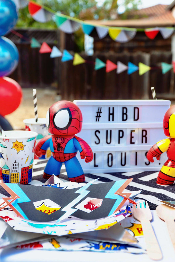 Boys Superhero Party Ideas_Superhero Themed Party Supplies on a table