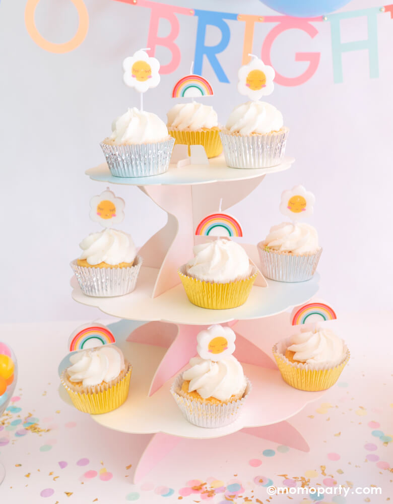 Rainbow Daisy Sun birthday cakes topped on cupcakes for a Good-Vibes themed party by Momo Party