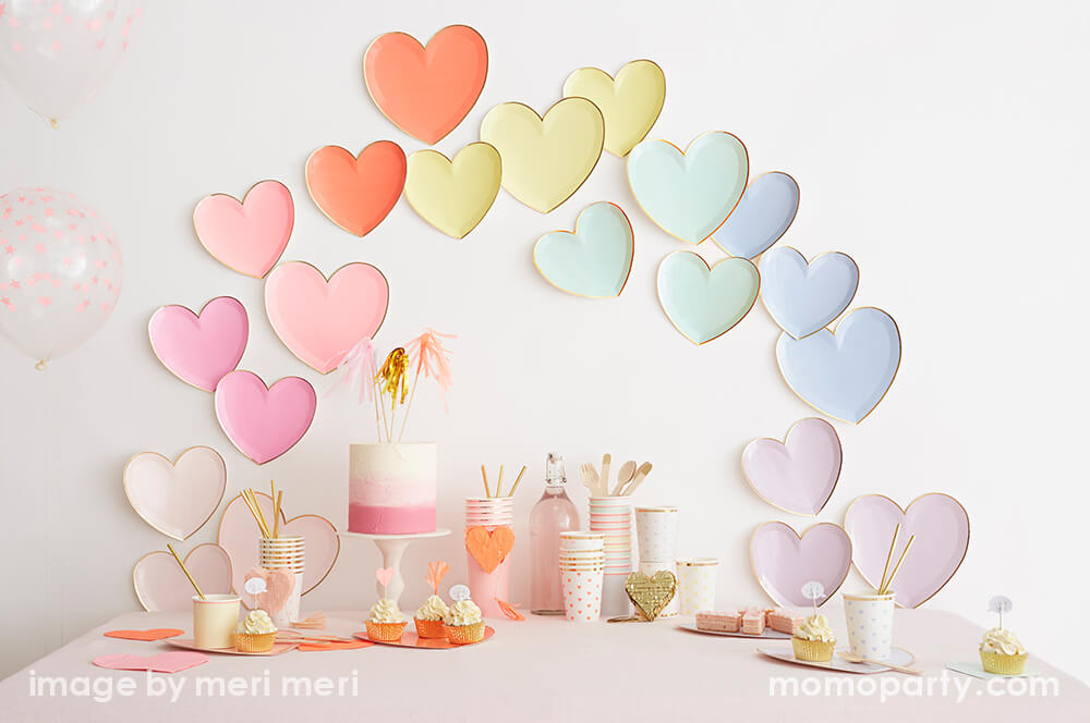 Valentines day party ideas of backdrop wall decoration with Meri Meri Party-Palette-Heart-Large-Plates in a rainbow color, pink naked cake, cups, desserts