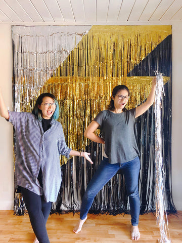 momo party owners finishing the black gold sliver fringe curtains made giant lighting bolt icon photo booth backdrop