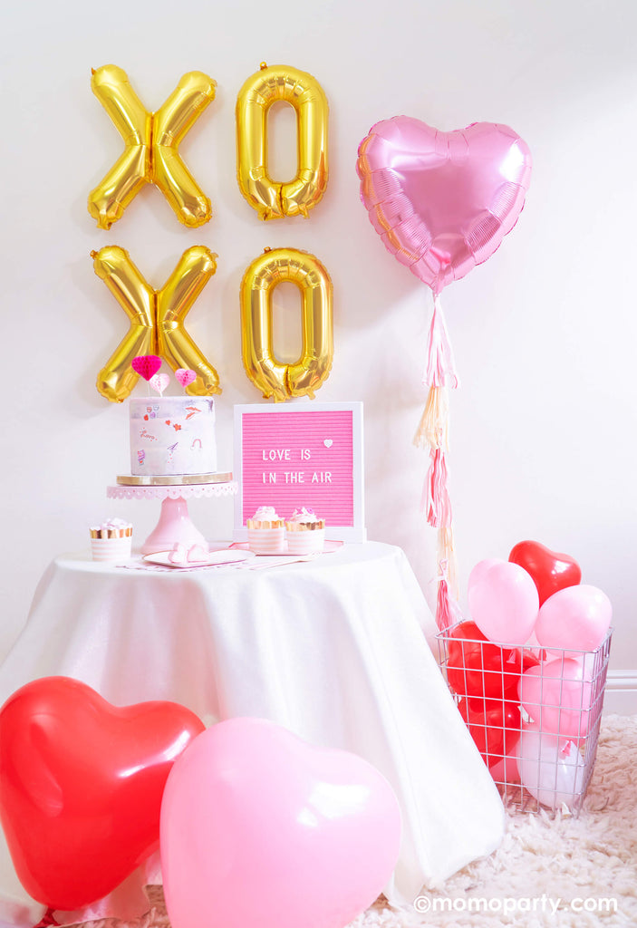 Valentine's Day Party Set up by Momo Party featuring XOXO and heart shaped balloons