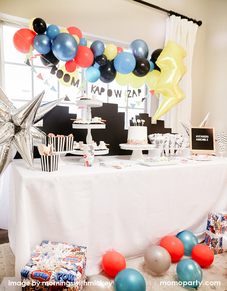 Boy's superhero birthday party at home simple set up with Momo Party's superhero party box which comes with easy decorations like balloon garland, banners, tableware and foil balloons