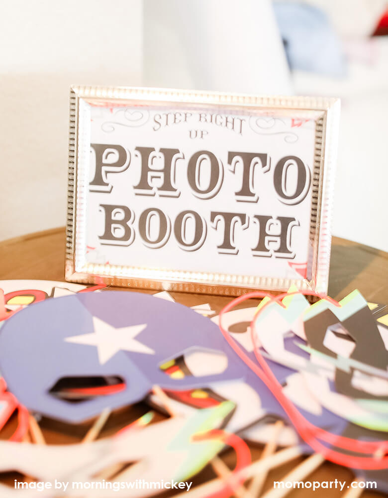 Kids superhero themed birthday party ideas Photo Booth fun with masks and props