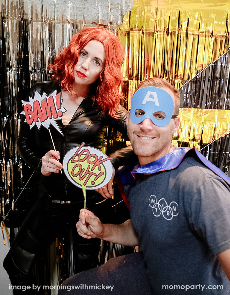 Superhero themed party photo booth ideas with props and masks for a costume photo opportunity!