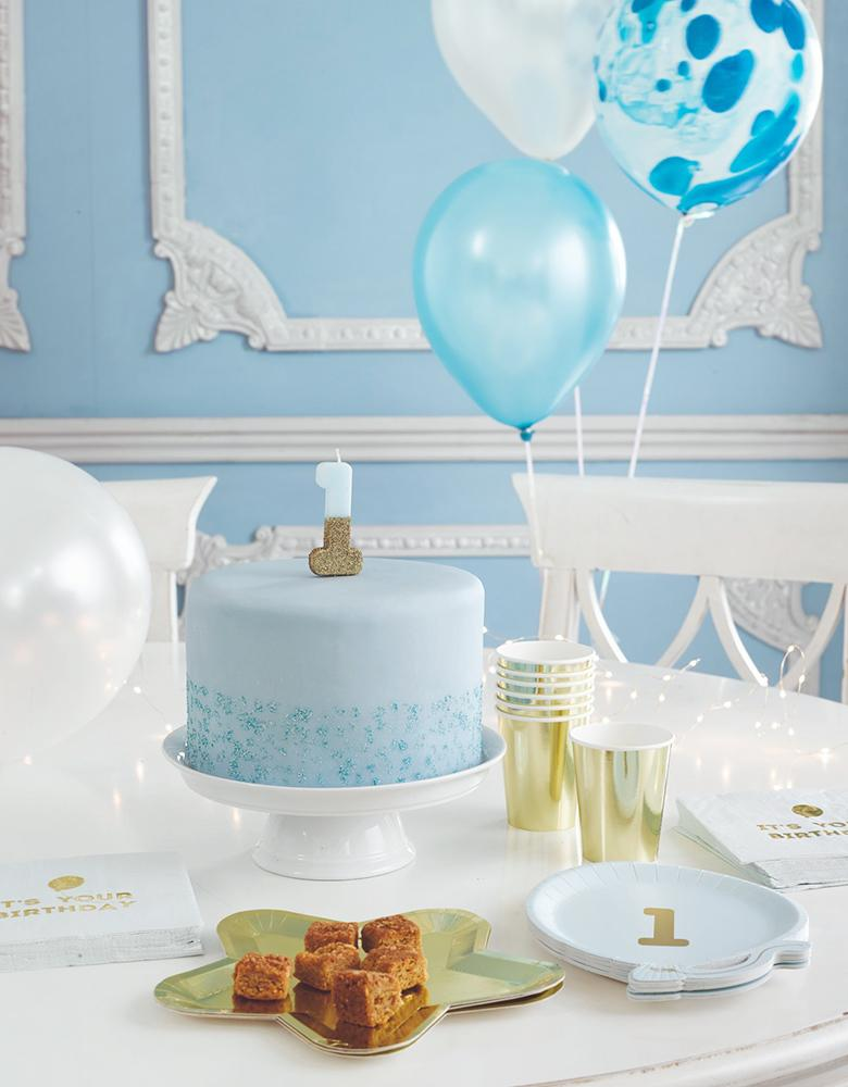 Talking Tables -  We Heart Birthday Glitter Number Candle Blue number 1 over a pastel blue cake for baby boy 1st birthday