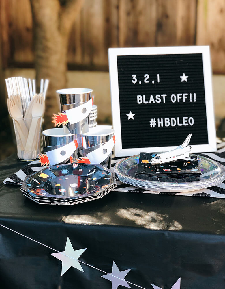 Space themed party with To The Moon Rocket Cups and plates
