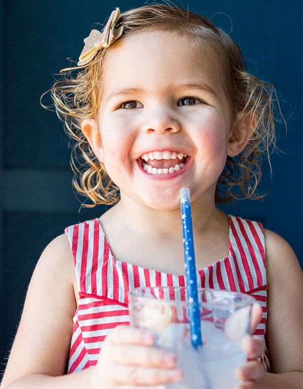 happy girl drinking with Blue Star Color Changing Straw
