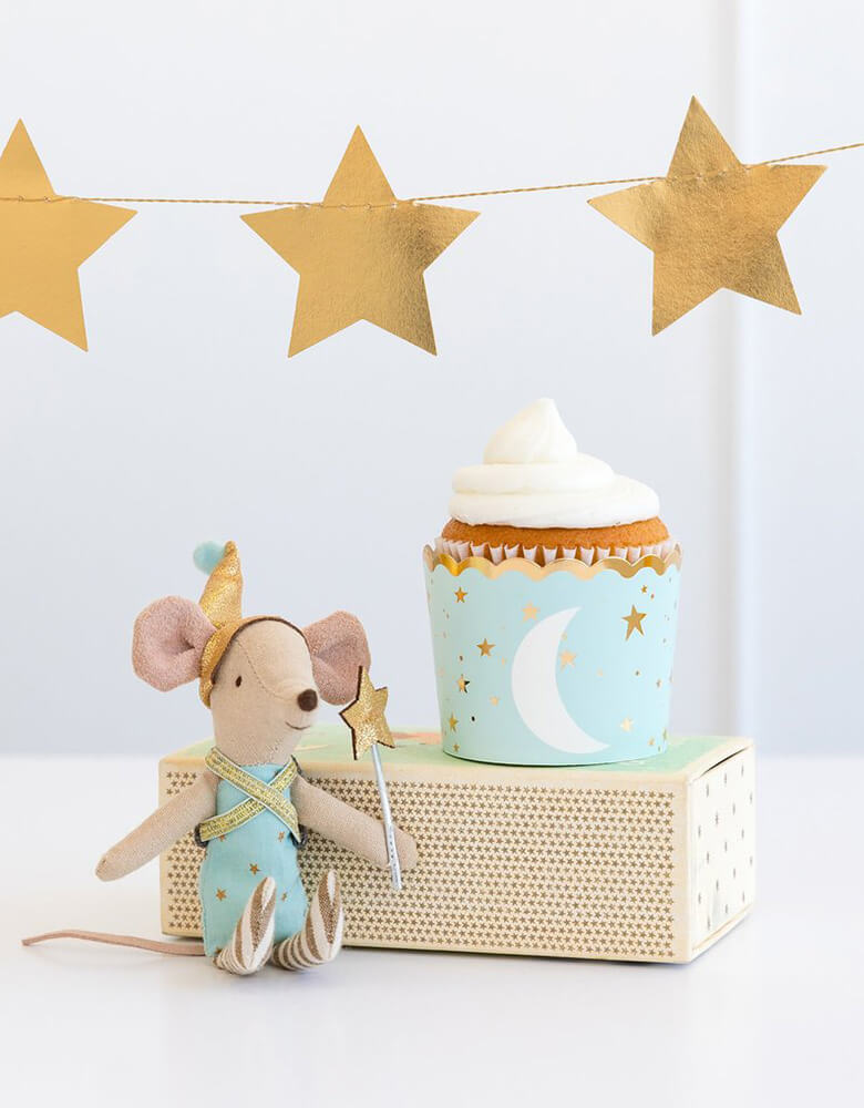 My Minds Eye Baby blue 5 oz Food Cup with a cupcake next to a stuffed mouse toy decoration with gold star party banner on the wall for a baby boy shower