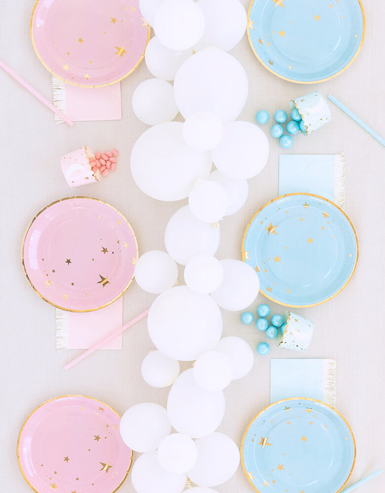 Baby Shower Gender Reveal Party table inspiration with My minds' eye Baby Blue Star Large Plates, Baby Blue Fringe Cocktail Napkins, Baby Blue Food Cups on one side, Baby Pink Star Large Plates, Baby Pink Fringe Cocktail Napkins,Baby Blue Food Cups on another side, white latex balloons as center piece