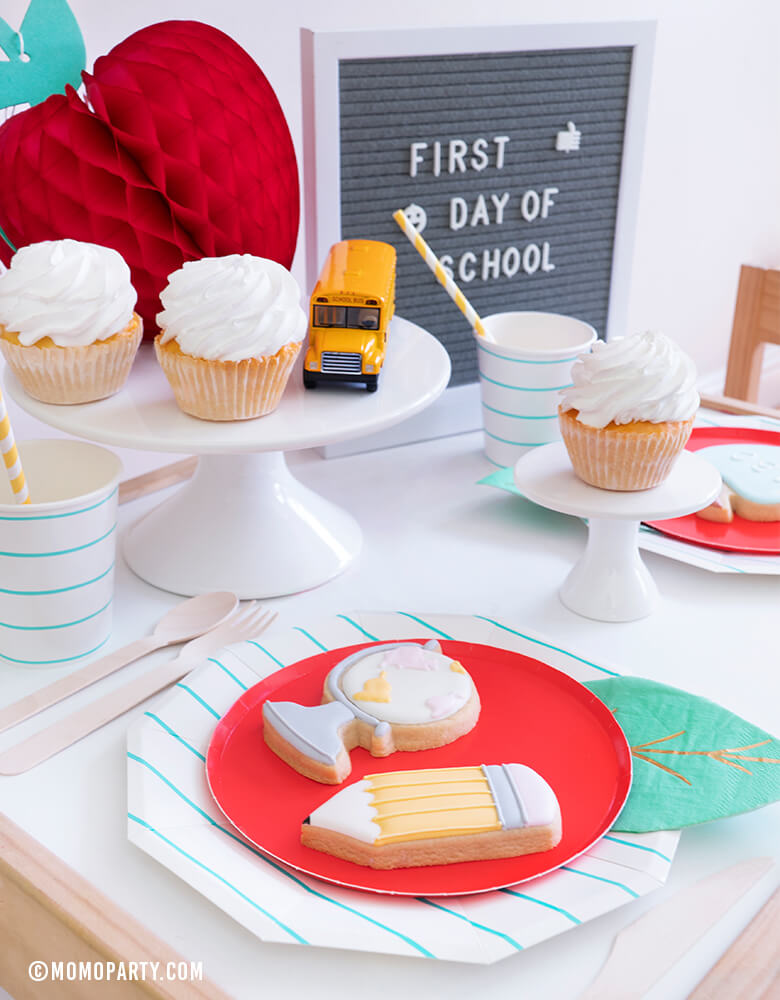 "Momo party - Modern Back To School Party Table inspiration with Oh happy day Cherry Red side plate with Meri Meri Leaf napkin represent as Apple. Aqua Striped Large Plates and cups, Leaf Napkins, Letter board with ""First Day of School"" sign,  , Honeycomb Apple, cupcakes, and school bus toy on cake stand as tableware"
