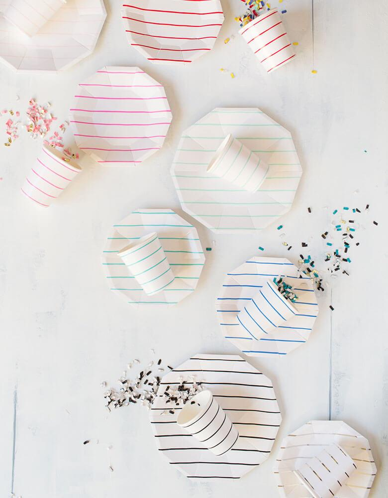 Daydream Society Frenchie Stripes Collection with party cups, plates, and napkin in different colors spread out