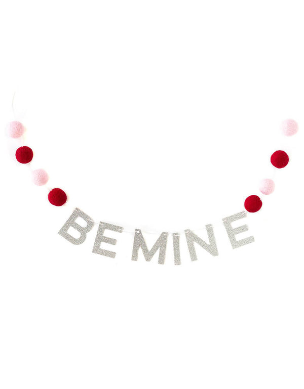 "My Minds Eye Be-Mine-Felt-Ball-Banner, featuring pink and red felt balls with the silver glitter phrase ""BE MINE"""