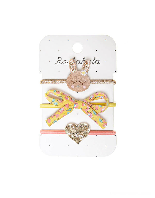 Rockahula Kids - Betty Bunny Hair Ties. This set of three hair ties feature a sweet bunny with a tiny flower, a hand tied bow in our blossom print, and a fabulous gold glittery heart. This set makes an adorable Easter basket filler for your little one in springtime!