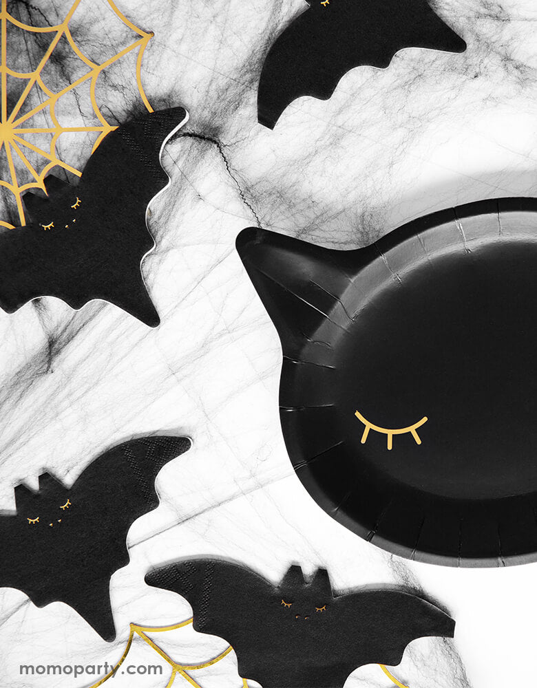 Halloween Party table with Party Deco Black Cat Halloween Plates in a cute Cat head die-cut Shape with eyes in a gold foil. and Black Bat napkins,  and Gold Spiderweb Decorations for a kid halloween party