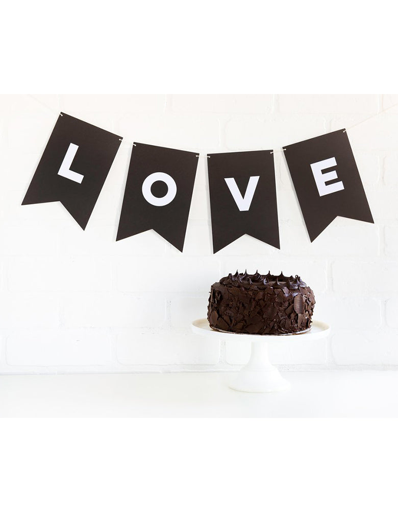 My Minds Eye Paper Love Black Letter Banner with Love message spelled out with a brownie cake on the party table