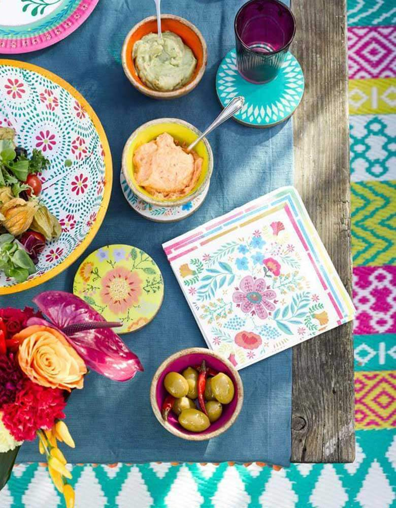 "A Boho Fiesta Themed Party Table featuring Talking Tables 9"" Boho Fiesta Floral Plates and Napkins with treats and fresh flowers"
