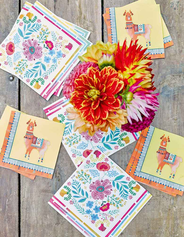 A fiesta themed party table featuring Talking Tables Boho Fiesta Floral Napkins and Llama napkins