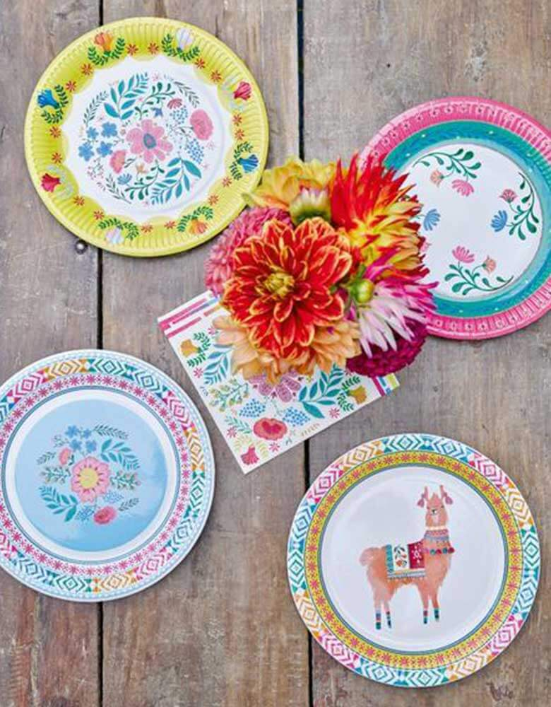 "A Boho Fiesta Themed Party Table featuring Talking Tables 9"" Boho Fiesta Floral Plates, Llama plates and Floral Napkins with fresh flowers"