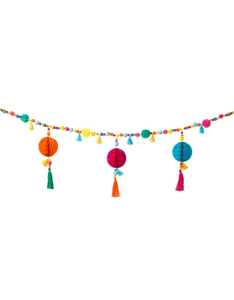 Talking Table_Boho Fiesta Pom Pom Garland with Pom poms and tassels combined with bead and paper honeycomb details for Fiesta party or cinco de Mayo celebrations or home decoration