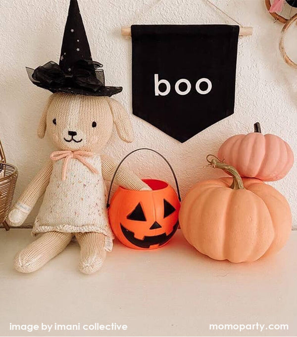 Halloween kid's room decoration with Boo hang Sign and cuddle and kind Mia the dog with a witch head accessory, a pumpkin trick or treat basket, 2 pink pumpkins, from Party Boutique Online at momoparty.com