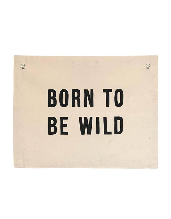 Imani Collective Born-To-Be-Wild-Banner. size 16 x 20 inches with 1/2 inch grommets. This modern hanging banner was sewn and screen printed by hand on natural canvas by local artisans in Kenya. It's a perfect decoration for your entrance hall, Nursery Decor, or your little wild one's playroom! Sold by Momo party store provided modern party supplies, boutique party supplies, chic holiday party supplies and high end party supplies