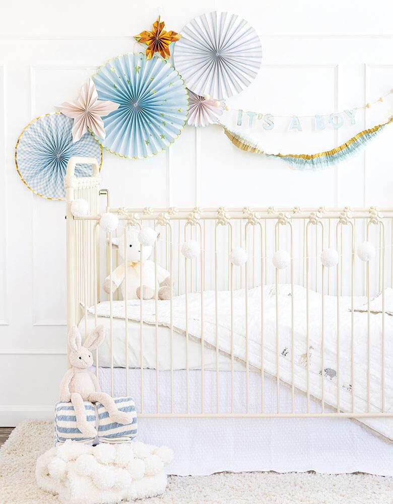 Baby boy's nursery decoration ideas featuring my mind's eye baby blue paper fan and it's a boy banner on the wall