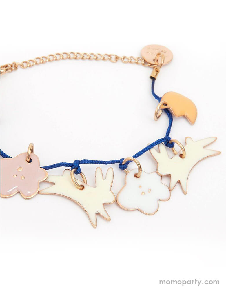Meri Meri Bunny Enamel Bracelet. Featuring 7 enamel charms with adorable enamel bunnies and flowers. Embellished with gold foil details and has a bold blue cord and gold tone chain and fastener. so cute for your non-chocolate gift for Easter