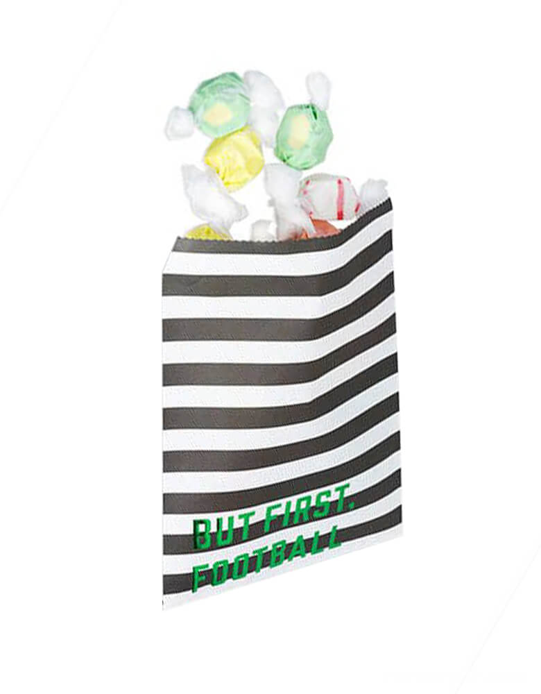 "Cakewalk partyware - But first Football treat bags, featuring black and white stripes with green foiled ""but first, football"" text on the paper bag. Wrap up treats and trinkets for your guests to enjoy when they return home with our playful, printed assortment of petite treat bags."