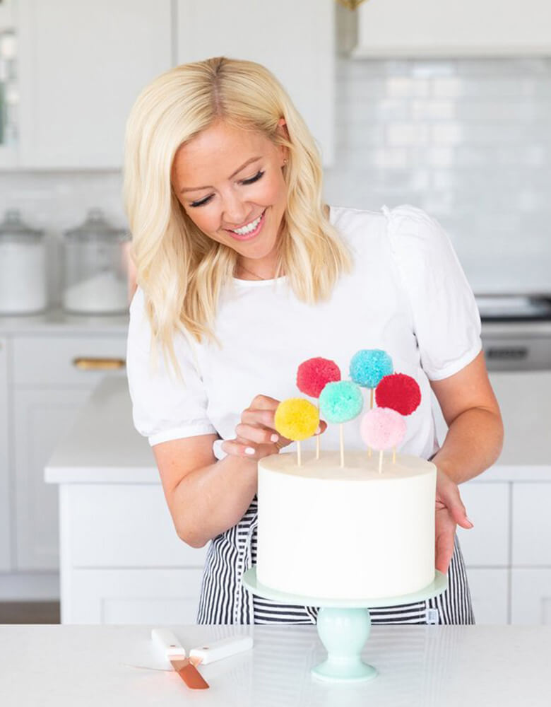 Courtney dresses her cake with the Pom Pom Cake Toppers